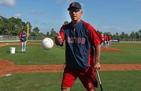 Valentine tossed a stray baseball into a basket as he walked briskly off the field.