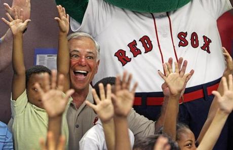As par of a team charitable program, Valentine visited a Fort Myers after-school program that provides reading and tutoring services.