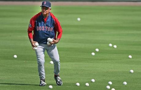 New Red Sox manager Bobby Valentine shagged balls in the outfield during a spring batting practice.