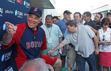 Valentine smiled as he prepared to talk to reporters on the day pitchers and catchers first reported.