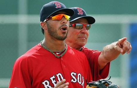 Valentine, whose management style is quite literally hands-on, pushed shortstop Mike Aviles into position during a drill.