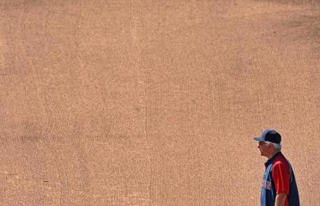 Valentine stood in the infield early in spring training. When he managed the Rangers in the '80s, Valentine was known to rake the infield himself before practice.