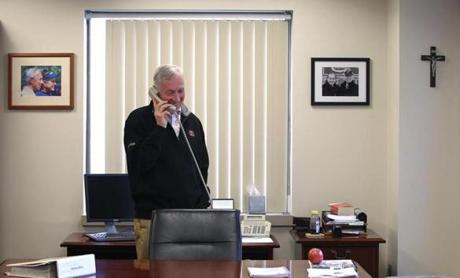 BC men's head hockey coach Jerry York stepped out of a meeting to take a good-luck call from Senator John Kerry. March 29, 2012.