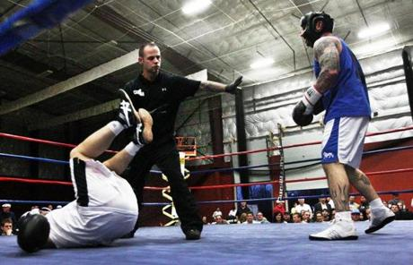 "Amateur boxer Nick Capobianco (right), an automotive technician, was sent to a neutral corner by referee Dan Conway after knocking down Joel Del Tufo, a truck driver, during the third and final round of their ""Battle at the Bay'' fight."