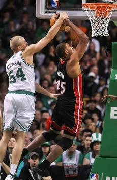 Celtics center Greg Stiemsma blocks the shot of Dexter Pittman of theMiami Heat at TD Garden, April 1, 2012.