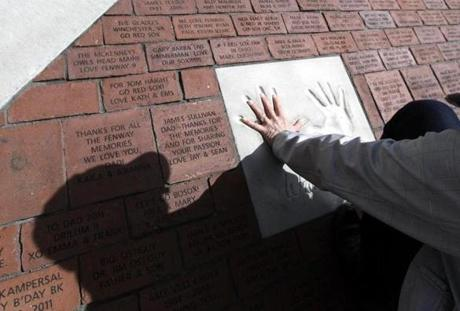 A fan compared her hand to the imprinted hand of the former Boston Red Sox third baseman on a brick walkway at Fenway Park.