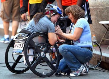 April 16, 2012: Shirley Reilly was congratulated by her mom, Dora at the finish line.  The wheelchair division for women was added to the race in 1977, two years after the men.