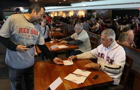 Red Sox alumni such as Ted Lepcio and Dick Beradino, right, signed autographs for fans.