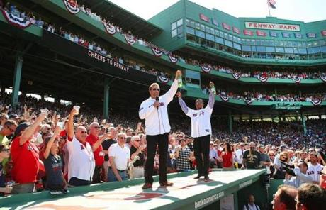 Kevin Millar and Pedro Martinez led the fans at Fenway in a toast to celebrate the 100th anniversary.