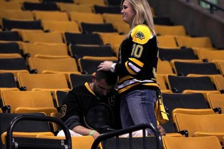 A Boston Bruins fan was consoled following his team's loss in overtime.