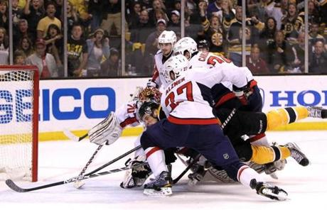 Bruins center Tyler Seguin was leveled in the crease in front of Washington Capitals goalie Braden Holtby.