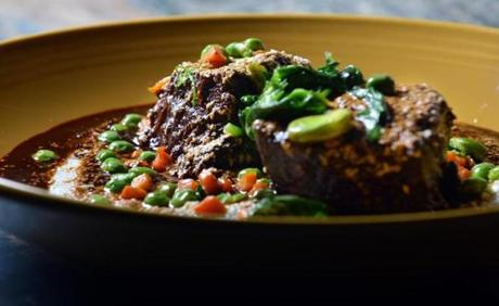 Short Rib Barbacoa, of Archer Angus beef, poblano and Oaxaca cheese grits, red wine Mexican cola mole, with peas and carrots, As prepared at The Painted Burro in Davis Square. JOSH REYNOLDS FOR THE BOSTON GLOBE (Living/Arts, Lifestyle, first)