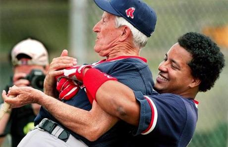 For generations of Red Sox players, Pesky was a source of baseball knowledge. Here, Manny Ramirez gave Pesky a bear hug at spring training in 2002.