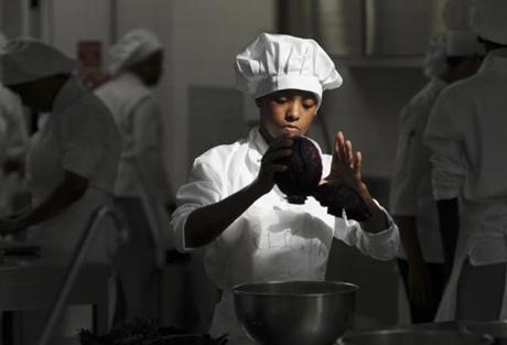 A tourism student in a culinary class at the Ecola de Hoteleria e Turismo de Cabo Verde. Foreign languages are important to the nation's hopes, especially English for business.