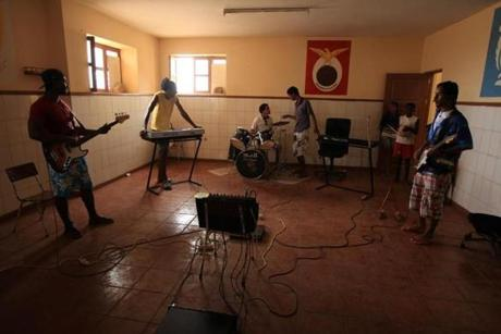 A band called Superacion practiced in Sao Vicente. Members said they plan to study music to improve their futures.