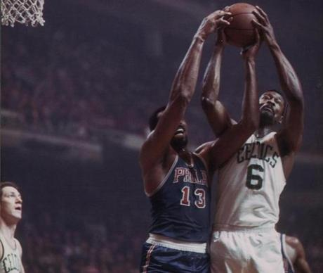 One of two vintage color photos of Bill Russell (seen here with in an undated image with rival Wilt Chamberlain) during his playing days.