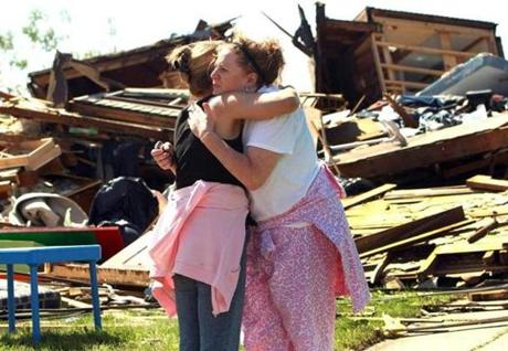 A devastating tornado moved though the town of Monson causing widespread destruction. Brenda Newton hugs her neighbor, Laura Yarbrough, whose home, on Stewart Ave., was flattened by the storm. (June 2, 2011)