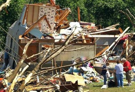 A devastating tornado moved though the town of Monson causing widespread destruction. Homeowners go through belongings of what remains of a Stewart Ave. home. (June 2, 2011)