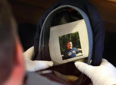 A Massachusetts State Trooper kept a funeral program with a photograph of Rice on the inside of his hat during the funeral service. (Dec. 30, 2011)