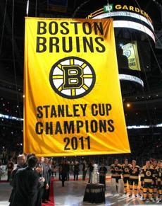 The Boston Bruins' championship banner is raised during a ceremony on the Garden ice. (Oct. 6, 2011)