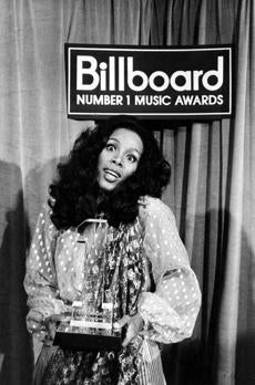 Donna Summer held her award at the Billboard Number 1 Music Awards in Santa Monica in 1997.