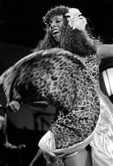 Summer swirled  the skirt of her leopard-print dress during her concert at the Universal Amphitheater in Los Angeles in 1979.