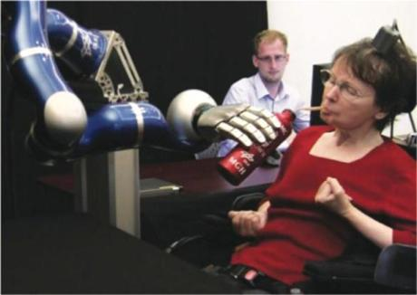 Cathy Hutchinson drinking froma bottle using the DLR robotic arm.