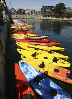 Vessels awaiting their passengers at North Shore Kayak Outdoor Center in Rockport.