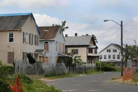 A row of condemned houses on Spruce Street.