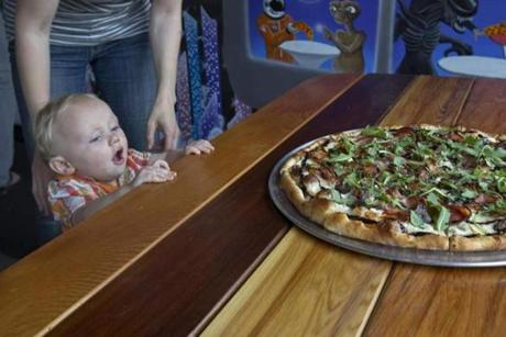 5/24/12 Cambridge, MA Rowan Nikula-Gill (cq), 1 year old from Cambridge with his mom, Allison Gill (cq) as he discovers the Buffalo Duck Confit pizza at All Star Pizza on Thursday May 24, 2012. (Matthew J. Lee/Globe staff) slug: 30cheap section: living Reporter: