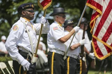 05/27/2012 MATTAPAN, MA Staff Sergeant Lester Smith (cq) of the American Legion Post 16's (cq) Color Guard, holds the American flag during a Memorial Day Service at Mt. Hope Cemetery (cq) in Mattapan. (Aram Boghosian for The Boston Globe)