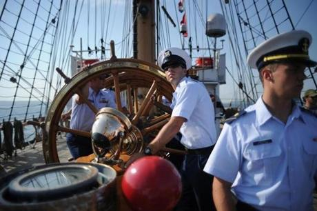 The USCG cadets of the tall ship, Barque Eagle, man the navigation table as they travel the New York Harbor on May 28, 2012 enroute to Norfolk, VA.