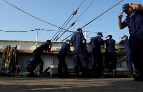 Crew members on deck on the USCG Barque Eagle a training ship on May 28, 2012 in route to Norfolk, VA.