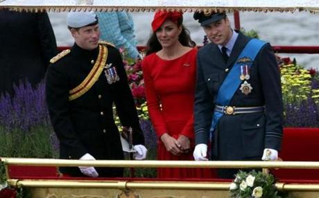 From left to right, Prince Harry, Kate Middleton, and Prince William, Duke of Cambridge on the royal barge