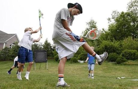 Brothers John Piatelli, 14, front, and Brian, 12, left, played a small lacrosse game with friends in Wrentham.