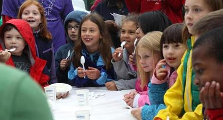 BOSOTN, MA -- 06/05/12- Students from the Cabot After School program in Newton watch as their fellow classmates participate in an ice cream eating contest during the 30th annual Jimmy Fund Scooper Bowl with proceeds supporting the Jimmy Fund Tuesday afternoon on City Hall Plaza. (Joanne Rathe / Globe Staff section: metro topic: 06scooper no reporter: )