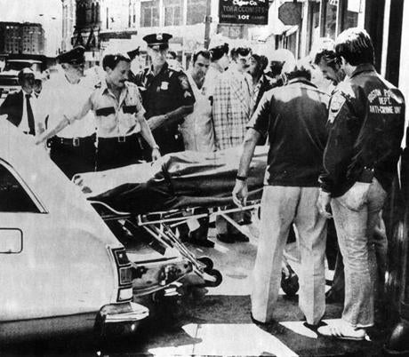 June 28, 1978: Boston police watched as as one of the Blackfriars victims was loaded into the medical examiner's station wagon. The victims were indentified as Vincent E. Solmonte, 35, of Quincy Shore Drive, Quincy; John A. (Jack) Kelly, 34, of Kendall Avenue, Framingham; Peter F. Meroth, 31, of the Jamaicaway, Jamaica Plain; Freddy R. Delavega, 34, of Jacques Street, Somerville, and Charles G. Magarian, 36 of Summit Street, North Andover.