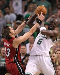 The Heat's Mike Miller and Celtics center Kevin Garnett fought for the ball in the second quarter.