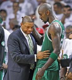 Celtics head coach Doc Rivers (left) and Kevin Garnett shared a moment on the sidelines as Garnett left the game as the clock was winding down. June 9, 2012.