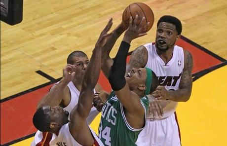 Paul Pierce faced triple coverage as he drove against the Heat defense.