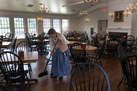 In the Abagail Tea Room, Chelsea White swept up the room.