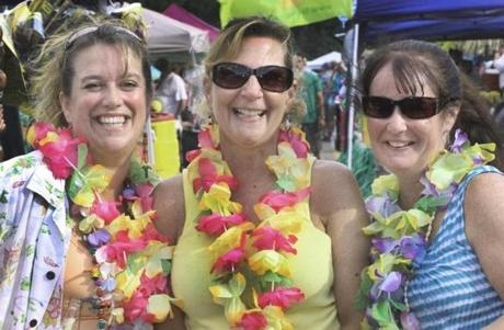 6-23-2012 Mansfield, Mass. Scene in the parking lot of the Comcast Center for Jimmy Buffett parrothead fans arrive for this show.L. to R. are Judy Barry of Peabody, Leslie Couture of Peabody and Ellen Jarmusik of Salem. Globe photo by Bill Brett