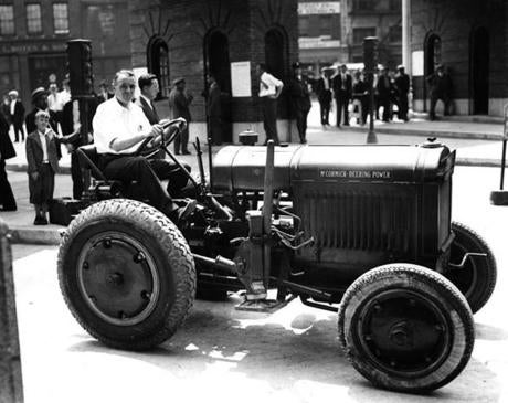 This $5000 tractor, photographed on July 2, 1934, was purchased by the city to keep the tunnel cleared of broken down vehicles. To pay for this machine, motorists were charged a 50 cent tax for towing and and a dollar a gallon for gas should they run out. Gas at this time was selling at 19 cents per gallon. John F. Lane, an official with the Public Works Department noted that though the money was needed to pay for the tractor, they would still turn away any rickety automobiles which could break down and delay traffic.