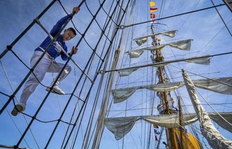 06/30/2012 BOSTON, MA Midshipman climb along the rigging of the ARC Gloria (cq) of Colombia, as it enters Boston Harbor (cq) during OpSail's (cq) Tall Ship arrival event. (Aram Boghosian for The Boston Globe)