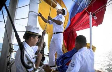 Crew members aboard the ARC Gloria of Colombia raised the flag.