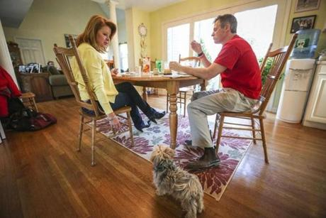 Gail Huff and Brown, shown with their dog Koda in their Wrentham home, married in 1986. She proposed to him.