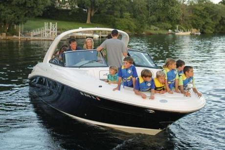 Mitt Romney, his wife Ann, and their grandchildren departed from the public docks on Lake Winnipesaukee.