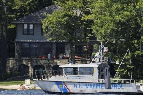 A Police Marine Patrol Boat is seen near the home of the Romneys.