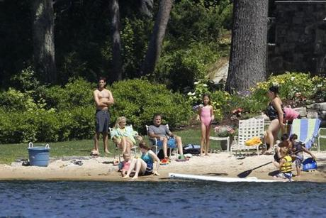 Mitt Romney and his family on the beach at his Wolfeboro home.