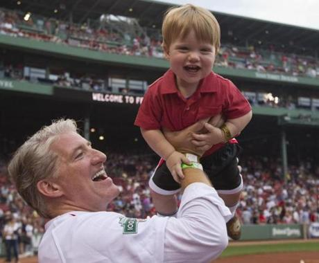 7/7/12 Boston, MA John King (cq) CNN chef national correspondent holding up his son Jonah King (cq), 1 before throwing out the first pitch of the Boston Red Sox/New York Yankees game at Fenway Park on Friday July 6, 2012. King received a call this morning from the Red Sox and was asked to throw out the first pitch. (Matthew J. Lee) slug: 08redsox section: sports reporter: